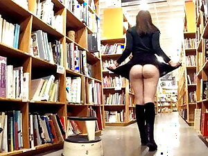 Cute brunette exhibitionist flashing at one's disposal make an issue of bookstore